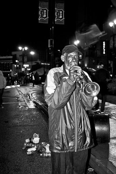 Trumpet Player In the Rain Detroit bw (1 of 1).jpg