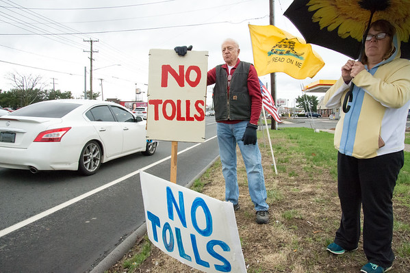 04/15/19 Wesley Bunnell | Staff Local TEA Party members protested taxes on Queen St. in Southington on April 15th which is the federal deadline for filing taxes. Dave Kimmel holds a No Tolls signs as he stands with Krista Politz during the protest.