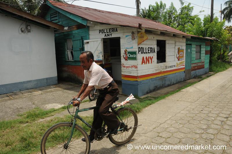 Guatemalan Man on Bike - Livingston, Guatemala
