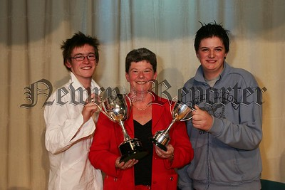 Rathfriland High School vice principal Amanda McCullough congratulates prize night award winners Christopher Liggett (left) who accepted the MJM Marine Cup for Community Work and Andrew Waddell who accepted the SJ Weir Cup for ICT at Key Stage 4. 48-30-06.