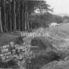 NJ910959A-LongView, Man marking Ordnance Survey minor control revision point with an arrow in 1950s