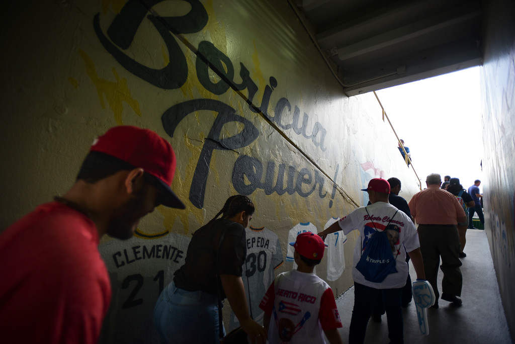 . Baseball fans enter Hiram Bithorn Stadium for the final game of a two-game Mayor League Series between the Minnesota Twins and the Cleveland Indians in San Juan, Puerto Rico, Wednesday, April 18, 2018. (AP Photo/Carlos Giusti)