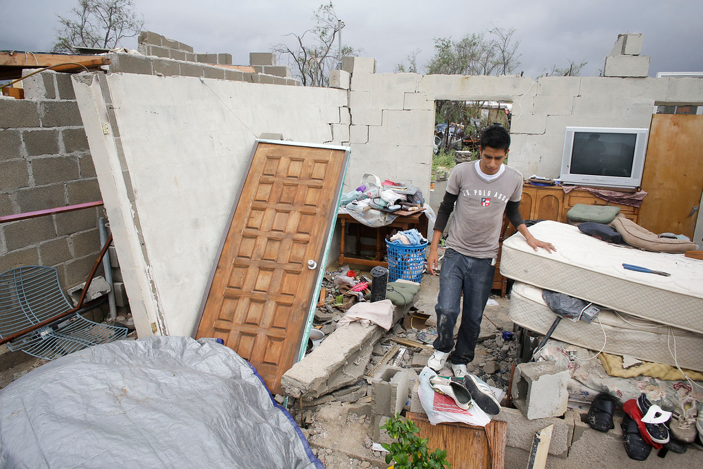 . Raimundo Diaz, 17, walks inside what it used to be a bedroom after his family\'s house was destroyed by Hurricane Odile in Los Cabos, Mexico,  Monday, Sept. 15, 2014. (AP Photo/Victor R. Caivano)