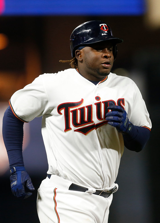 . Minnesota Twins\' Miguel Sano jogs home on a solo home run off Cleveland Indians relief pitcher Dan Otero during the eighth inning of a baseball game Tuesday, April 18, 2017, in Minneapolis. The Indians won 11-4. (AP Photo/Jim Mone)