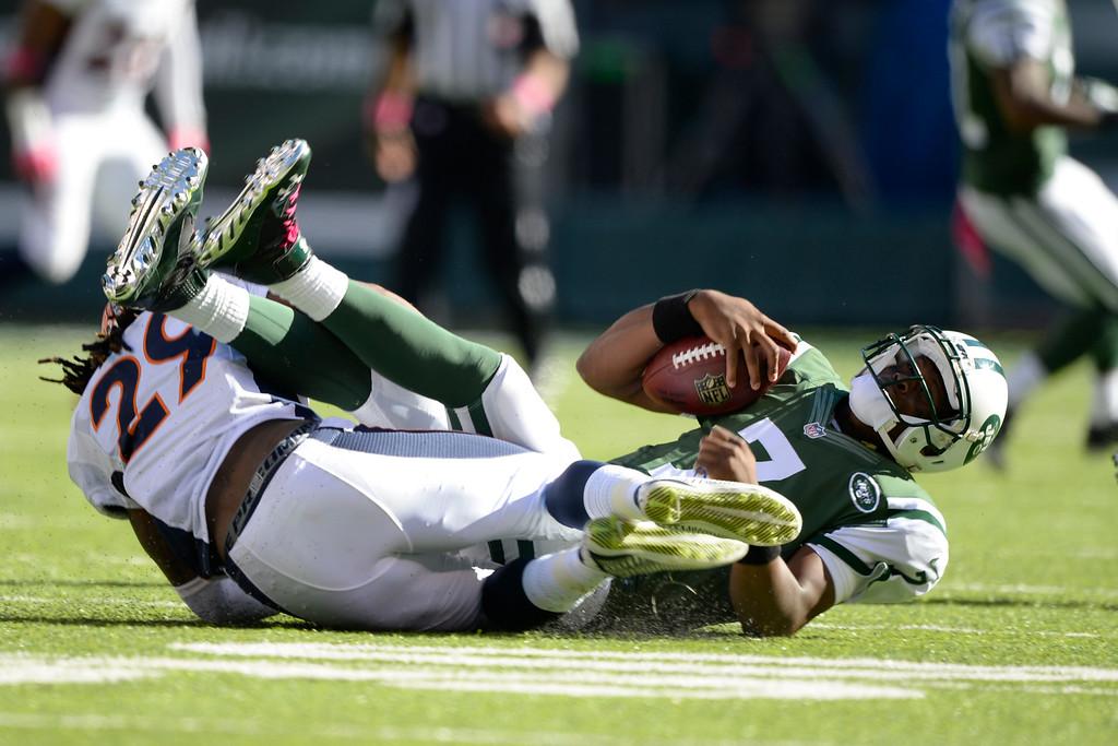 . Denver Broncos cornerback Bradley Roby (29) sacks New York Jets quarterback Geno Smith (7) during the third quarter  October 12, 2014 at Metlife Stadium. (Photo by John Leyba/The Denver Post)