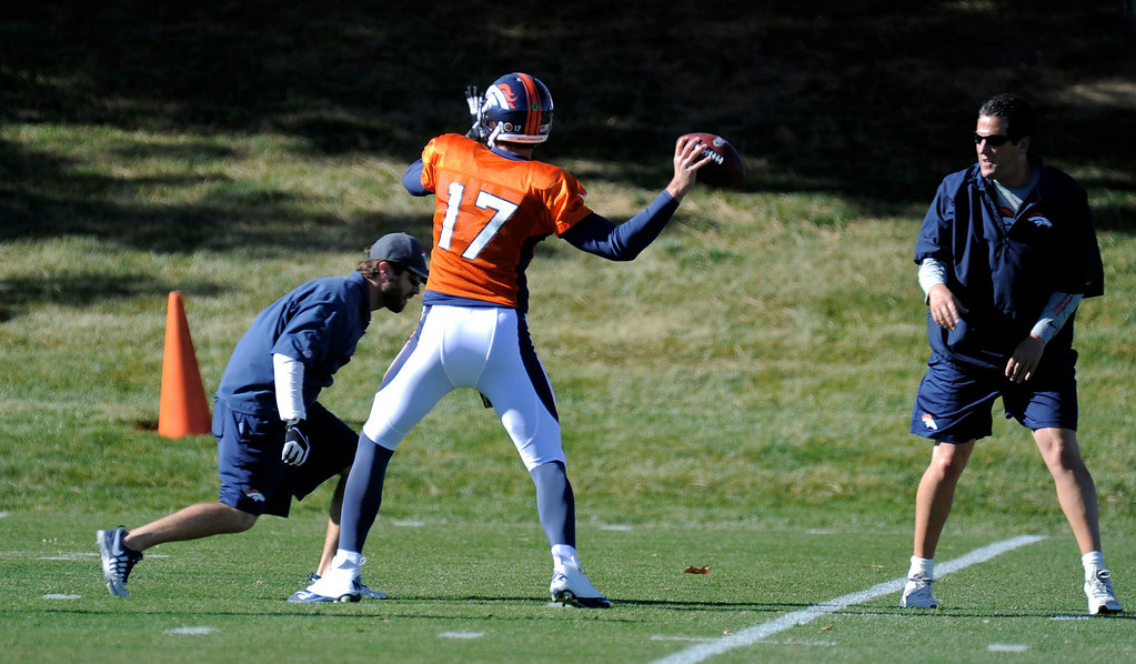. Denver Broncos quarterback Brock Osweiler (17) throws down field during practice November 13, 2013 at Dove Valley. Brock took the snaps on the day as Peyton Manning was held out of practice. (Photo by John Leyba/The Denver Post)