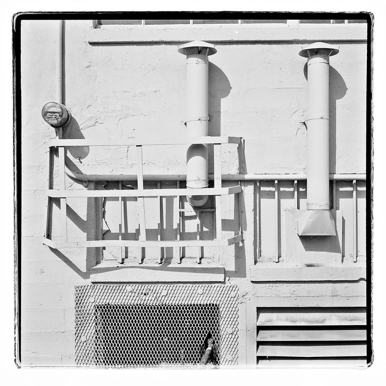 Pipes and chimneys on a wall, Seattle, Washington, 1993,  HP5 Plus.