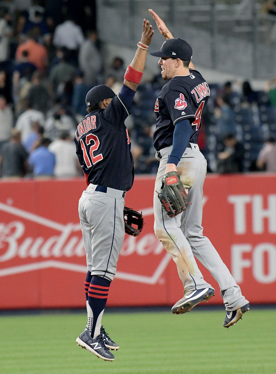 . Cleveland Indians shortstop Francisco Lindor, left, and center fielder Bradley Zimmer celebrate after the Indians defeated the New York Yankees 6-2 in a baseball game Monday, Aug. 28, 2017, at Yankee Stadium in New York. (AP Photo/Bill Kostroun)