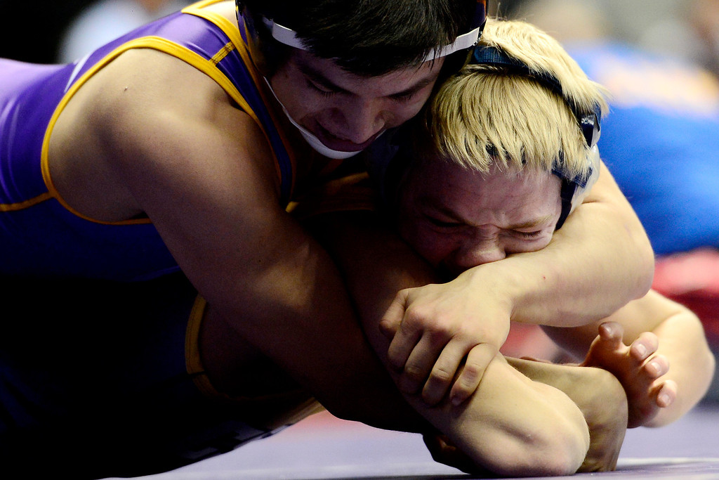 . DENVER, CO - FEBRUARY 21: Basalt 126-pounder Hector Chagoya controls CS Christian\'s Brian Follett during the Colorado State High School Wrestling Championships. The state finals will run through Saturday evening at the Pepsi Center. (Photo by AAron Ontiveroz/The Denver Post)