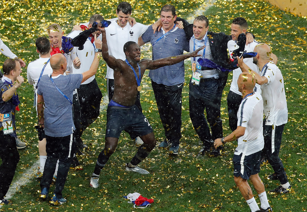 . French teammates celebrate after winning the final match between France and Croatia at the 2018 soccer World Cup in the Luzhniki Stadium in Moscow, Russia, Sunday, July 15, 2018. (AP Photo/Frank Augstein)