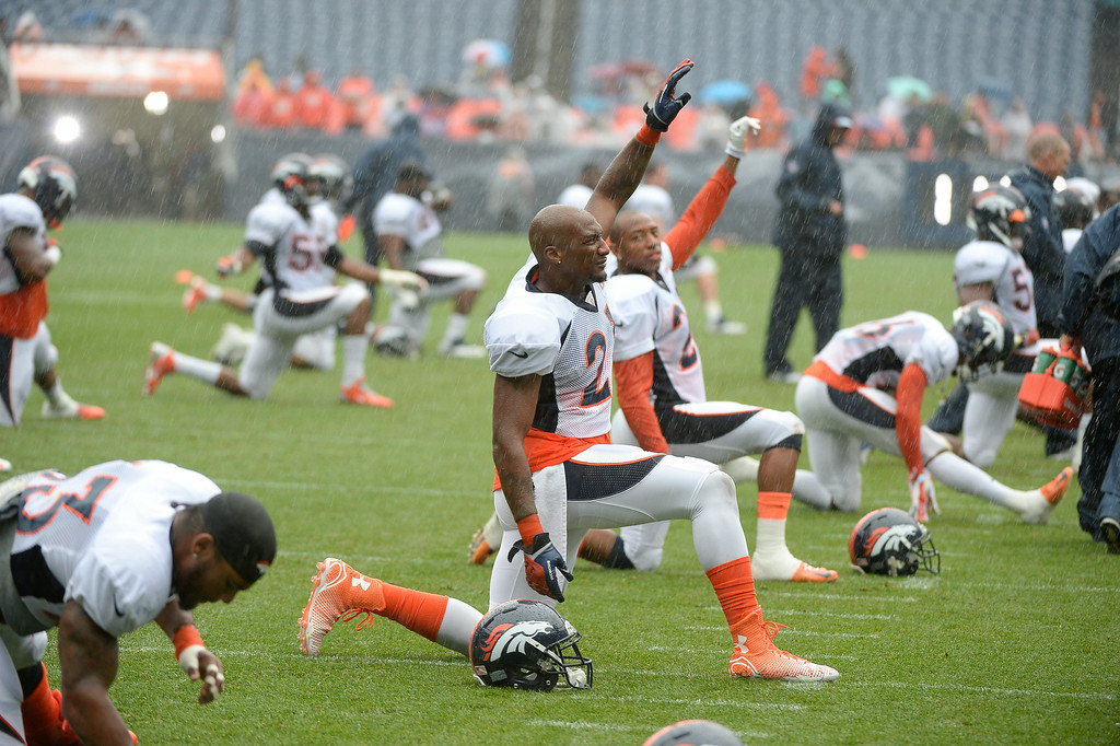 . Denver Broncos cornerback Aqib Talib (21) stretches during a rain day on day six of the Denver Broncos 2014 training camp July 30, 2014 at Sports Authority Field at Mile High Stadium.  (Photo by John Leyba/The Denver Post)
