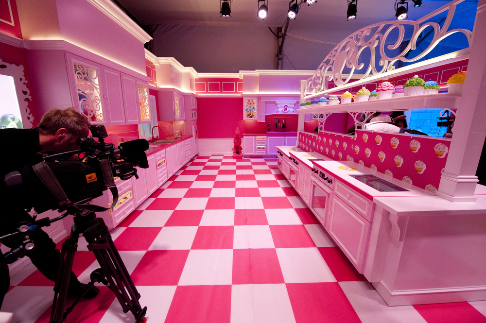 . A cameraman films the pink kitchen at the Barbie Dreamhouse - the first life-sized giant mansion dedicated to the doll in Europe, ahead of its opening near the Alexanderplatz in Berlin on May 16, 2013. BARBARA SAX/AFP/Getty Images
