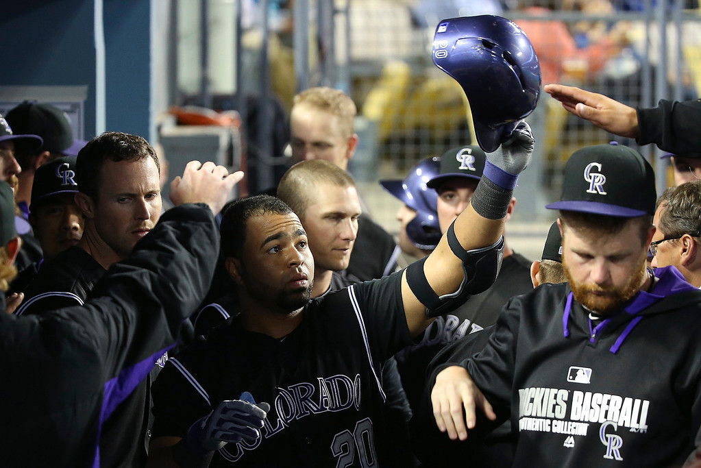 . Wilin Rosario #20 of the Colorado Rockies celebrates with teammates in the dugout after hitting a solo home run in the fourth inning during the MLB game against the Los Angeles Dodgers at Dodger Stadium on June 16, 2014 in Los Angeles, California.  (Photo by Victor Decolongon/Getty Images)