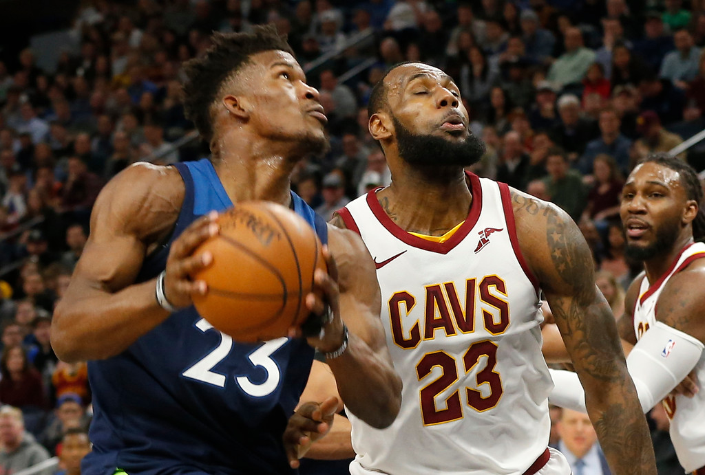 . Minnesota Timberwolves\' Jimmy Butler, left, drives past Cleveland Cavaliers\' LeBron James in the first half of an NBA basketball game Monday, Jan. 8, 2018, in Minneapolis. (AP Photo/Jim Mone)