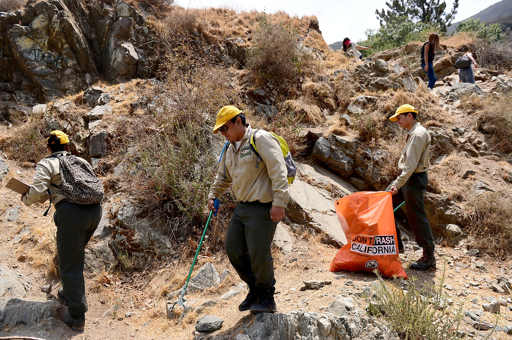 . Members of the Urban Conservation Corps pick up trash along the East Fork of the San Gabriel River in the Angeles National Forest Saturday, July 20, 2013. Although the Urban Conservation Corps says their river trash count studies show less trash the area is still littered with garbage. (SGVN/Staff Photo by Sarah Reingewirtz)