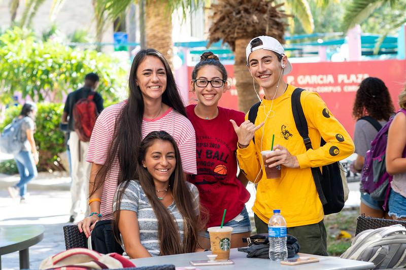 Saige Martinez (left), Paula De Jesus, Talor Appel, and Raine Martinez (bottom row) grab refreshments and lounge at the Starbucks patio.