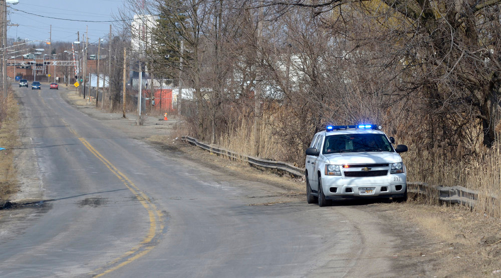 . An Ohio State Patrol vehicle sits along Pine Avenue S.E. in Warren, Ohio, where six teens were killed in an accident where the vehicle they were traveling in went off the roadway and into a pond, Sunday, March 10, 2013. (AP Photo/Tribune Chronicle, R. Michael Semple)