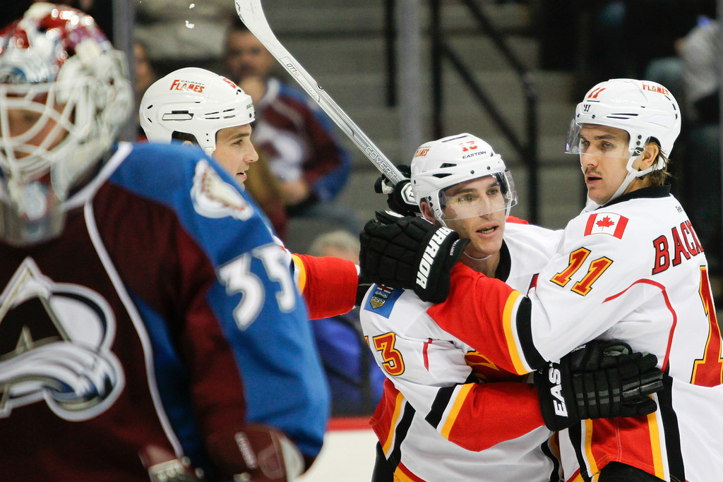 . Calgary Flames\' Mike Cammalleri (13) and Mikael Backlund (11), of Sweden, celebrate Cammalleri \'s goal during the second period of an NHL hockey game against the Colorado Avalanche, Friday, Nov. 8, 2013, in Denver. (AP Photo/Barry Gutierrez)