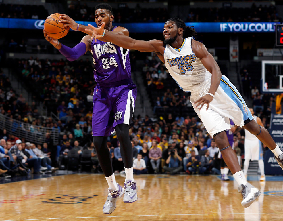 . Sacramento Kings forward Jason Thompson, left, fields inbounds pass as Denver Nuggets forward Kenneth Faried reaches for a steal in the third quarter of the Kings\' 110-105 victory in an NBA basketball game in Denver on Monday, Nov. 3, 2014. (AP Photo/David Zalubowski)