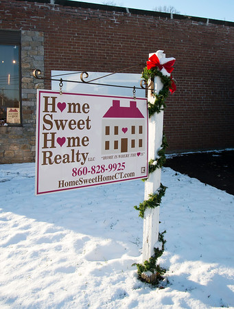 12/11/19 Wesley Bunnell | StaffrrHome Sweet Home Realty located at 359 Main St in Berlin with Christmas decorations on its sign on Wednesday December 11, 2019.