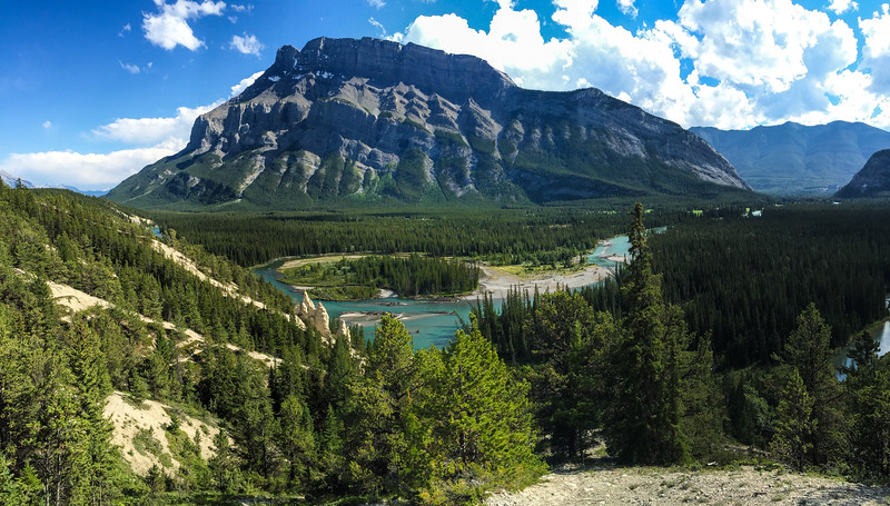 """One of my absolute favorite views, and the home to one of my favorite photos, was taken here, along the Hoodoo Trail just outside the town of Banff. I took Sammi straight here. You can see some of the """"hoodoo""""'s in the middle left of the photo -- those white rocky looking stick thingy things."""