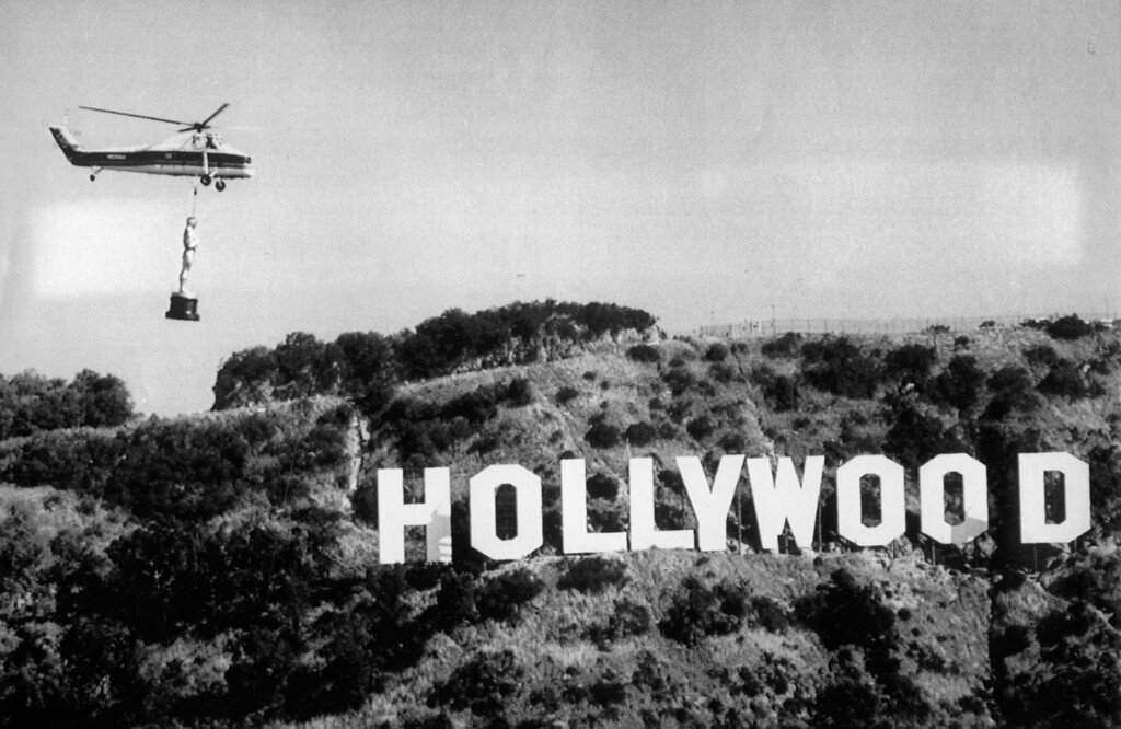 . Oscar is airlifted past the Hollywood Hills and the famous Hollywood sign en route to the Shrine Auditorium in Los Angeles for the 60th Academy Awards presentation. 4/8/88 (L.A. Daily News file photo)