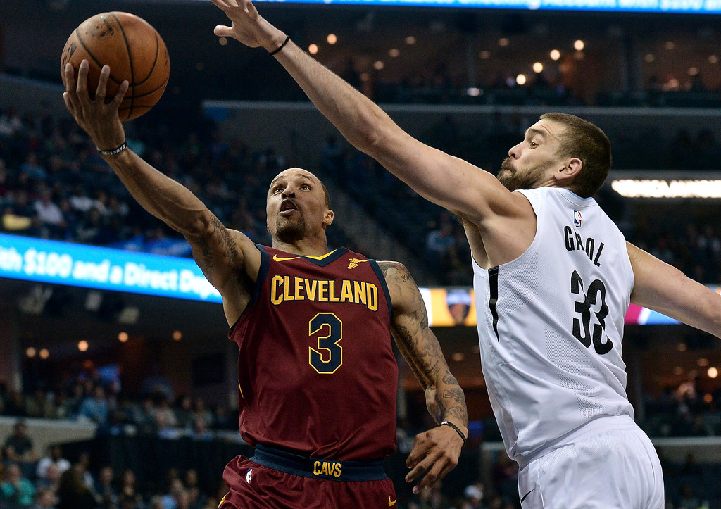 . Cleveland Cavaliers guard George Hill (3) shoots against Memphis Grizzlies center Marc Gasol (33) during the first half of an NBA basketball game Friday, Feb. 23, 2018, in Memphis, Tenn. (AP Photo/Brandon Dill)