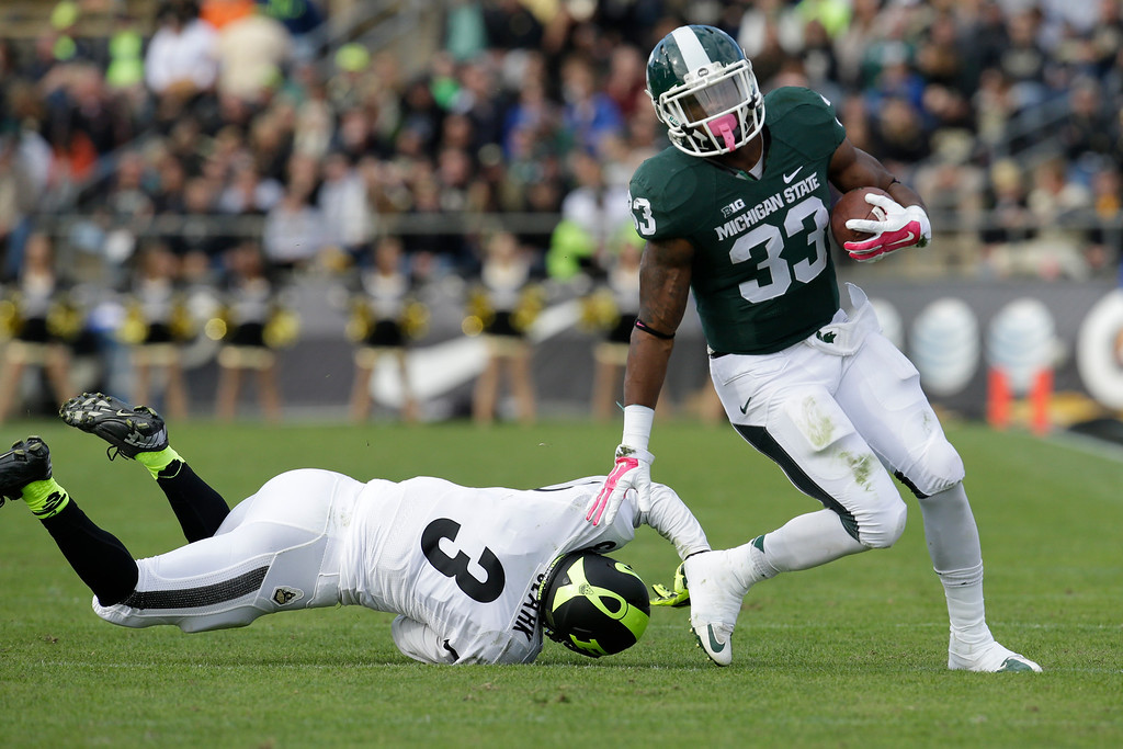 . Michigan State running back Jeremy Langford (33) as Michigan State played Purdue in an NCAA college football game in West Lafayette, Ind., Saturday, Oct. 11, 2014. Michigan State won 45-31. (AP Photo/AJ Mast)