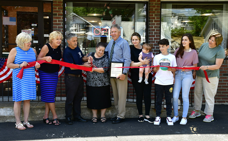6/27/2019 Mike Orazzi | Staff Plymouth Mayor David Merchant and the Central CT Chambers of Commerce during  a ribbon cutting and certificate presentation at the Eagles Nest in recognition for their recent facade improvements on Route 6 in Terryville.