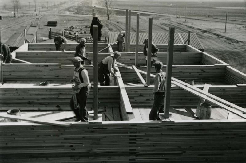 JA034.  Building annex on Farmers Elevator Co. – 1939 .jpg