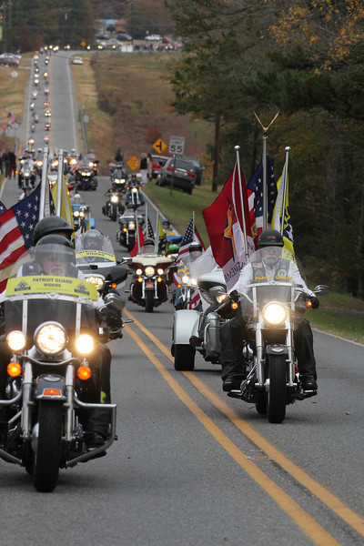 The Patriot Guard escort the precession for Staff SGT Chris Newman's memorial service.