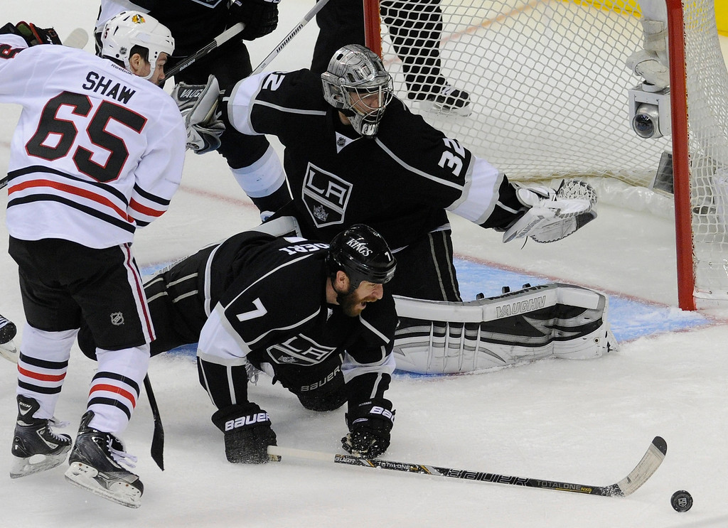 . Kings#7 Rob Scuderi and Kings#32 Jonathan Quick keep Blackhawks#65 Andrew Shaw and the puck from fining the net in the 3rd period. The Kings defeated the Chicago Blackhawks in the 3-1 in the 3rd game of the Western Conference Finals. Los Angeles, CA 6/4/2013(John McCoy/LA Daily News4