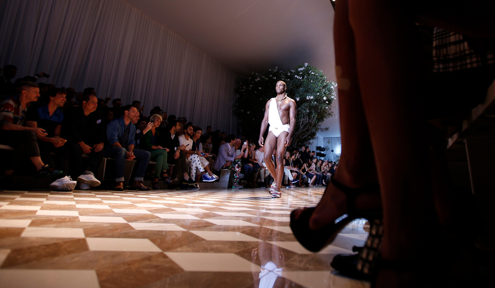. A model wears a creation for Versace men\'s Spring-Summer 2015 collection, part of the Milan Fashion Week, unveiled in Milan, Italy, Saturday, June 21, 2014. (AP Photo/Luca Bruno)