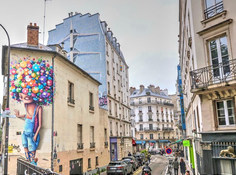"Lots of colorful street art in the ""grittier"" neighborhoods of Paris"