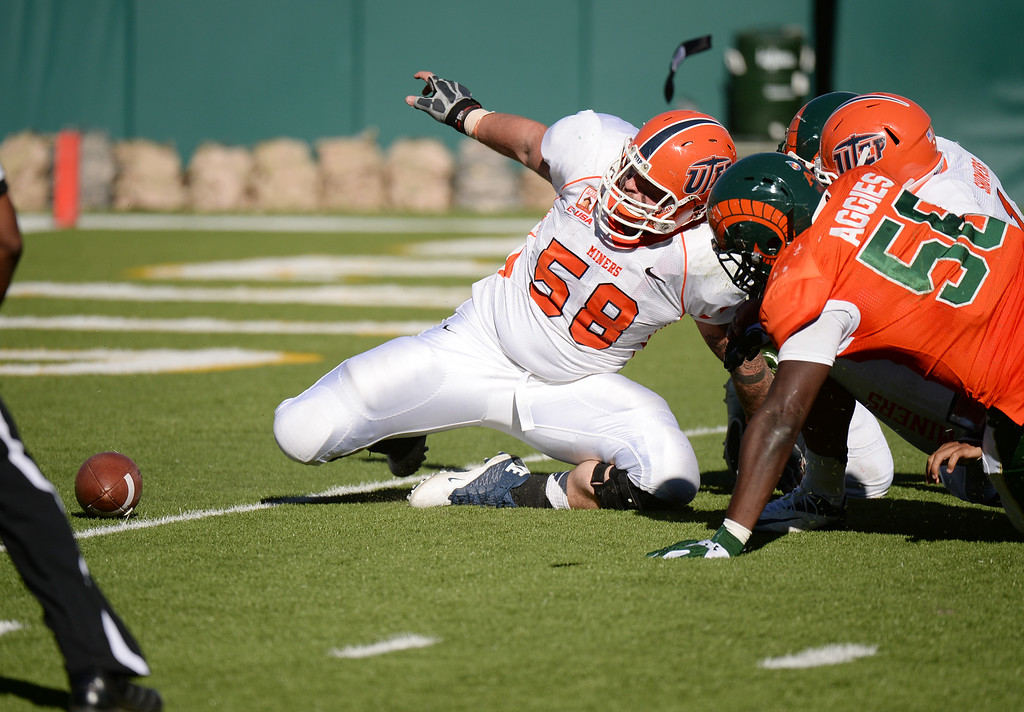 . FORT COLLINS, CO - September 28 : Shaquil Barrett of Colorado State University (56), left, sacks QB Jameill Showers of University of Texas at El Paso (1) and scores a safety by Brander Craighead of UTEP (58) in the 3rd quarter of the game at Hughes Stadium. Fort Collins, Colorado. September 28, 2013. CSU won 59 - 42.(Photo by Hyoung Chang/The Denver Post)