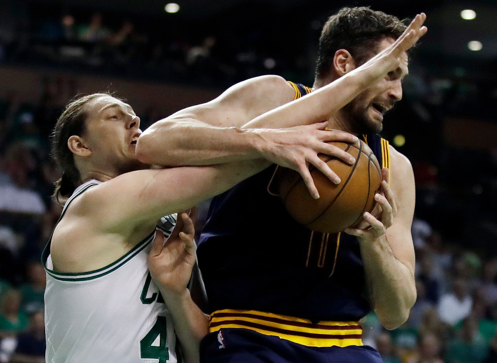 . Boston Celtics center Kelly Olynyk, left, and Cleveland Cavaliers forward Kevin Love vie for a rebound during the first quarter of Game 1 of the NBA basketball Eastern Conference finals, Wednesday, May 17, 2017, in Boston. (AP Photo/Charles Krupa)