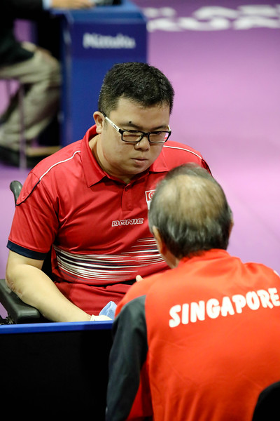 PARA TABLE TENNIS - Singapore's JASON CHEE interacting with his coach during Men Team - Round Robin Match against Team Indonesia at MITEC Hall 7 on September 17th, 2017 (Photo by Sanketa Anand)