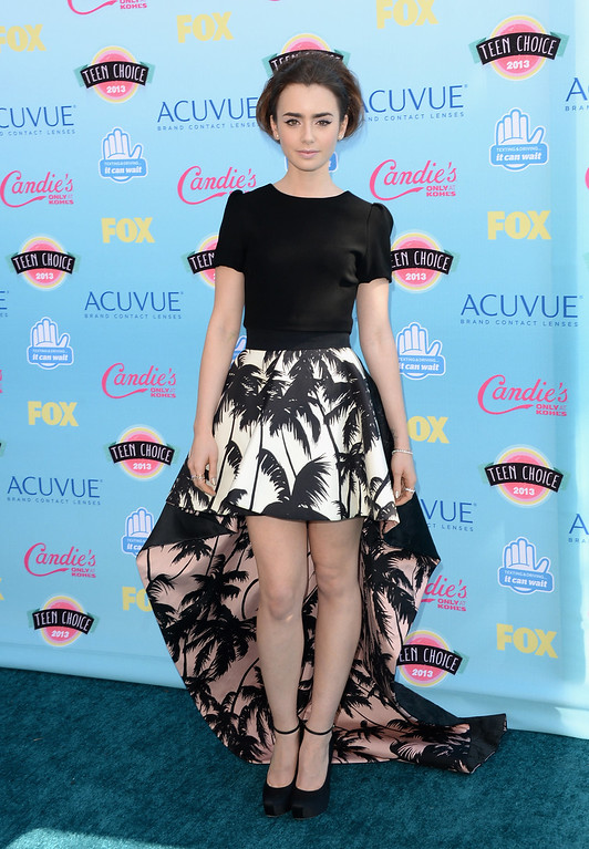 . Actress Lily Collins attends the Teen Choice Awards 2013 at Gibson Amphitheatre on August 11, 2013 in Universal City, California.  (Photo by Jason Merritt/Getty Images)