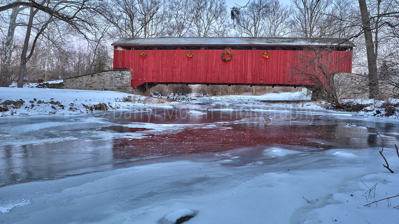 Red Covered Bridge over Frozen River