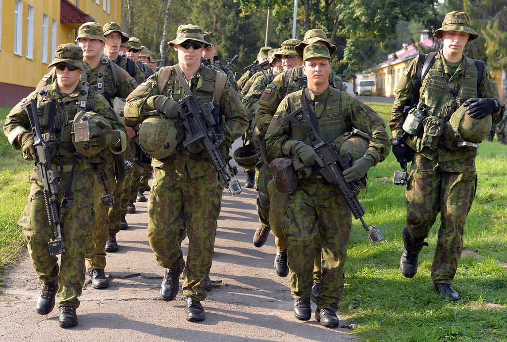 ". Lithuanian servicemen walk following the opening ceremony of the ""Rapid Trident\"" military exercises on September 15, 2014 near the western Ukrainian town of Yavoriv. US-led military exercises began in Ukraine on Monday after a day of deadly fighting between government forces and pro-Russian rebels in the restive east that has piled pressure on a shaky 10-day-old truce. AFP PHOTO/YURKO DYACHYSHYN/AFP/Getty Images"