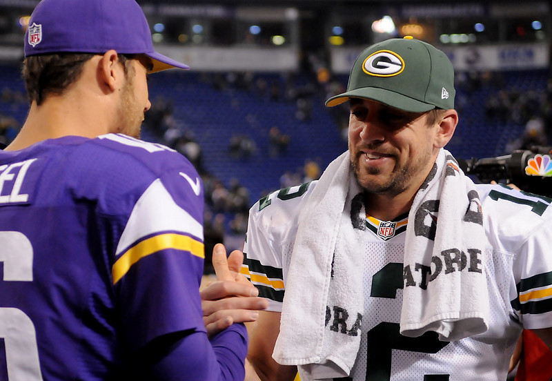 . Green Bay quarterback Aaron Rodgers and Minnesota quarterback Matt Cassel, left, chat after the game. (Pioneer Press: John Autey)