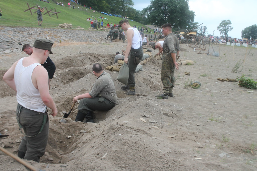 . Reenactors dig trenches/graves on the beach at Conneaut while reenacting the Invasion of Normandy during D-Day Conneaut on Aug .17. Kristi Garabrandt - The News-Herald