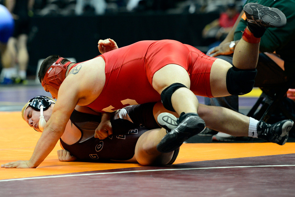 . DENVER, CO - FEBRUARY 21: Pueblo Centennial 220-pounder Damian Garcia takes Golden\'s Noah Lennox out of bounds en route to a win by way of a fall during the Colorado State High School Wrestling Championships. The state finals will run through Saturday evening at the Pepsi Center. (Photo by AAron Ontiveroz/The Denver Post)