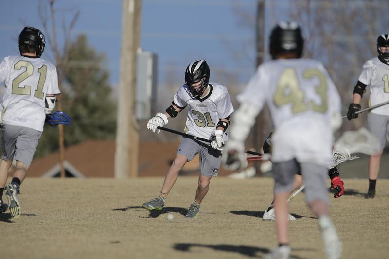JPM0309-JPM0309-Jonathan first HS lacrosse game March 9th.jpg
