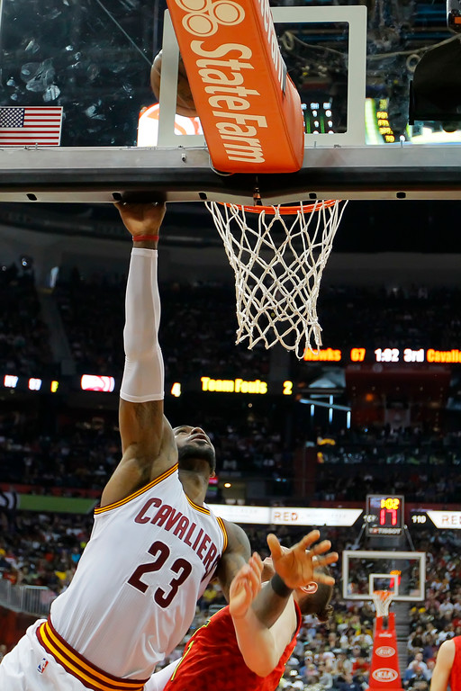 . Cleveland Cavaliers forward LeBron James (23) goes up for the shot in the second half of an NBA basketball game against the Atlanta Hawks on Sunday, April 9, 2017, in Atlanta. The Hawks won in overtime 126-125. (AP Photo/Todd Kirkland)