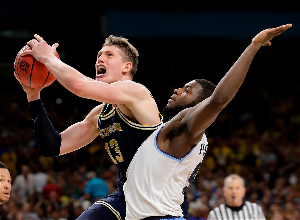. Michigan\'s Moritz Wagner (13) shoots over Villanova\'s Eric Paschall (4) during the second half in the championship game of the Final Four NCAA college basketball tournament, Monday, April 2, 2018, in San Antonio. (AP Photo/Eric Gay)