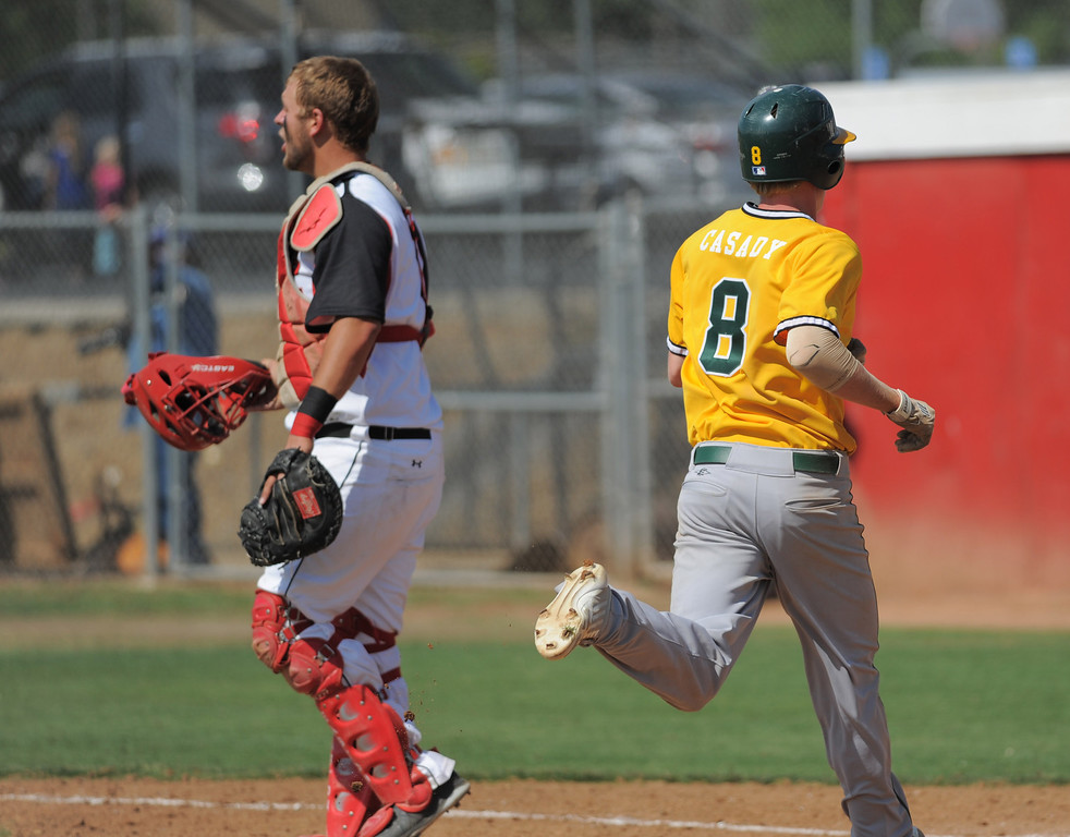 . 05-28-2013-( Sean Hiller/LANG) Mira Costa beat Elsinore 5-3 in Tuesday\'s CIF Southern Section Division III semifinal at Elsinore High School. Braden Casady brings a Costa run off of a triple by Grant Livornese.