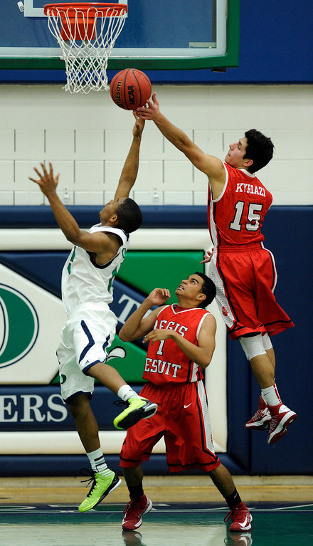 . Blazers guard Austin Conway (15) and Regis Regis guard George Kyriazi (15) battled for a rebound in the second half. The Overland High School boy\'s basketball team defeated Regis Jesuit 80-66 Tuesday night, December 11, 2012.  Karl Gehring/The Denver Post