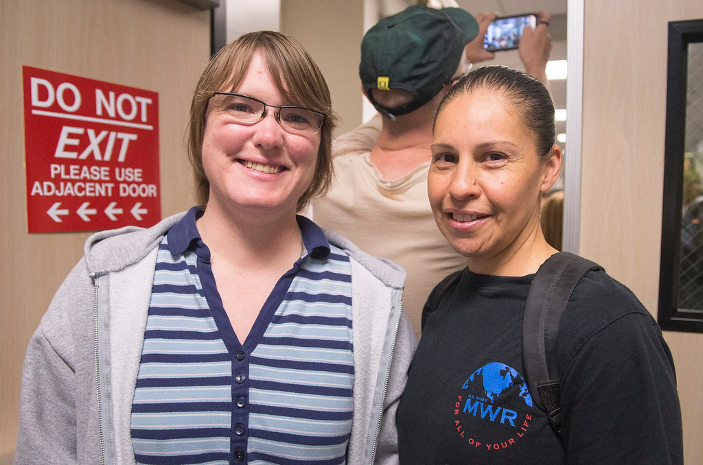 . Rebecca Kipper, left, and Alexandria Rosas of Downey wait in line to receive their marriage license at the Los Angeles County Registrar-Recorder/County Clerk office in Norwalk, Ca. July 1, 2013.   (SGVN staff photo by Leo Jarzomb)