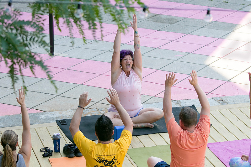 The first day of free outdoor yoga started Saturday at 9:30 AM at the new Mill Street stage, July 27, 2019. Instructor Cera Hawkins of Good Karma Yoga Therapy in Fitchburg leads the class. SENTINEL & ENTERPRISE/JOHN LOVE